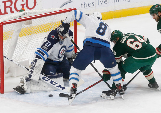 Connor Hellebuyck, Mikael Granlund, Jacob Trouba